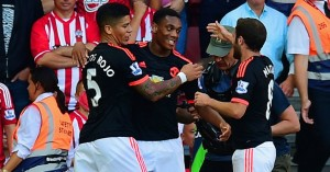 Anthony Martial (c): Celebrates his goal with Marcos Rojo and fellow scorer Juan Mata