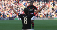 Juan Mata: Celebrates Manchester United's third goal at Southampton