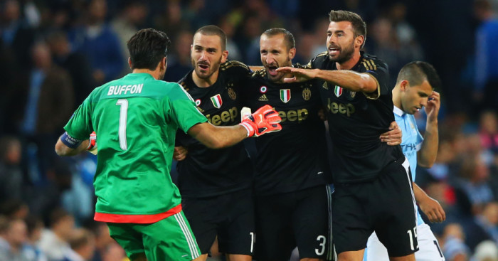Gianluigi Buffon, Leonardo Bonucci, Giorgio Chiellini and Andrea Barzagli of Juventus celebrate victory