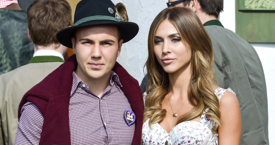 Bayern Munich's German midfielder Mario Gotze and his girlfriend Ann Kathrine Broemmel dressed in traditional Bavarian clothing. TEAMtalk