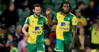 Dieumerci Mbokani (right): One of four strikers available to Norwich boss Alex Neil