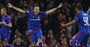 Kostas Fortounis: Celebrates Olympiakos' second against Arsenal in the Champions League