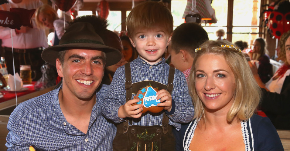Philipp Lahm attends with his wife Claudia and his son Julian