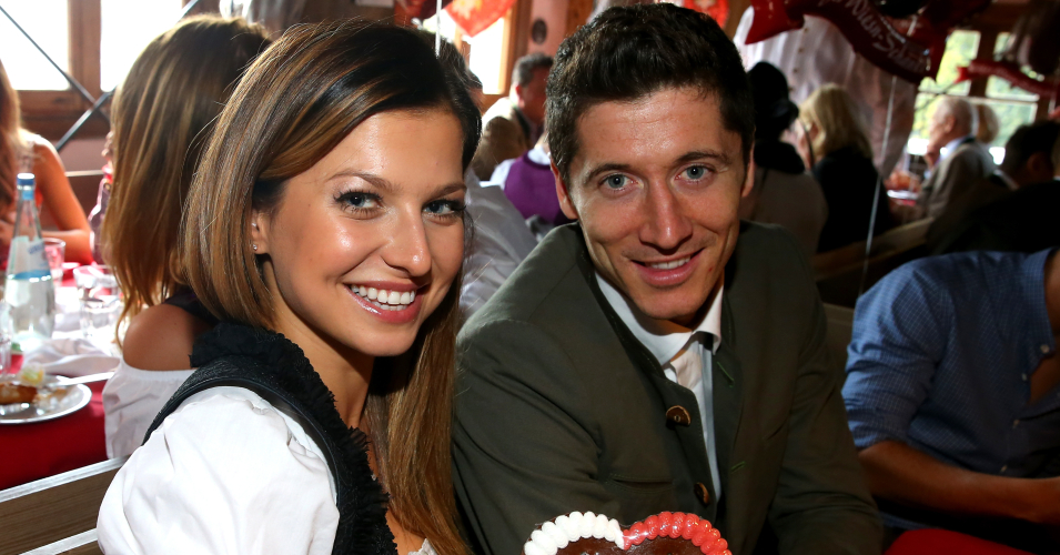 Robert Lewandowski of FC Bayern Muenchen attends with Anna Stachurska