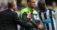 Papiss Cisse: Celebrates a goal with Newcastle boss Steve McClaren