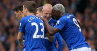 Steven Naismith: Mobbed after scoring Everton's second against Chelsea