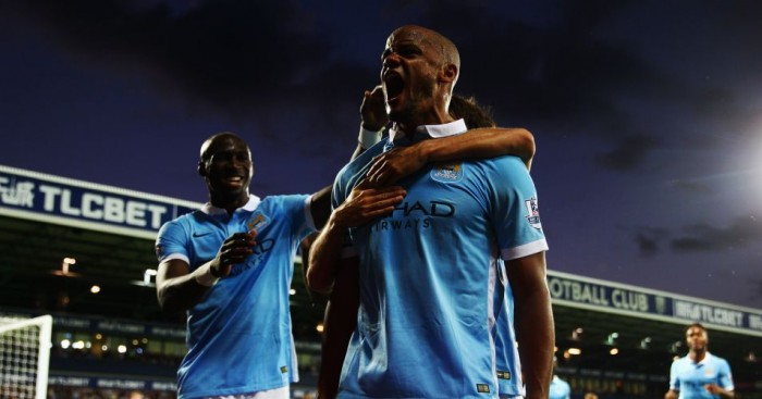 Vincent Kompany: Celebrates scoring for Manchester City at West Brom