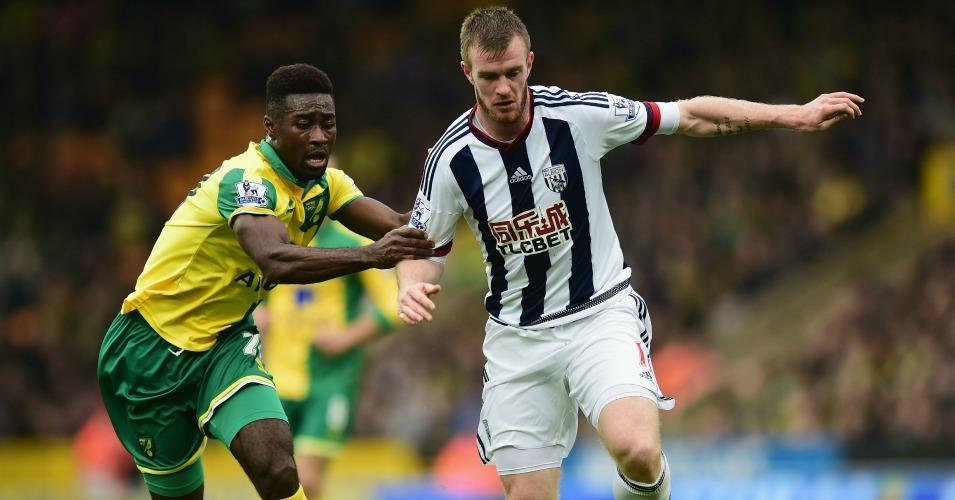 Chris Brunt: Holds off Norwich's Alexander Tettey