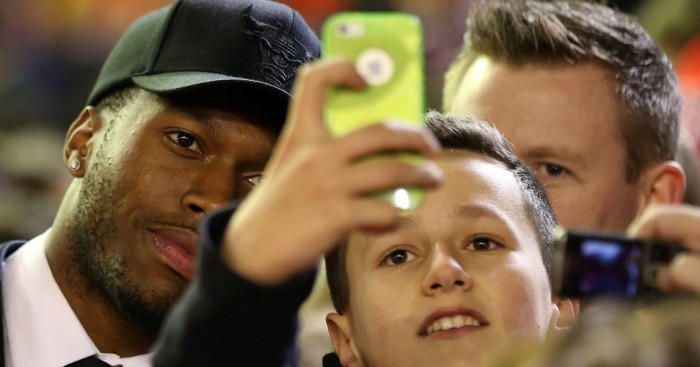 Daniel Sturridge: Poses for photo at Liverpool's game against Bournemouth