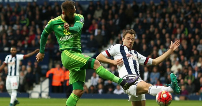 Jonny Evans: Tries to block a Steven Fletcher shot