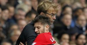 Jurgen Klopp: Liverpool boss embraces a tired Adam Lallana at Tottenham