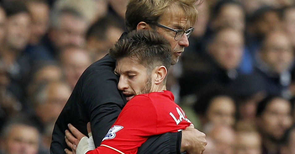 Adam Lallana gets a cuddle after being substituted int he second half