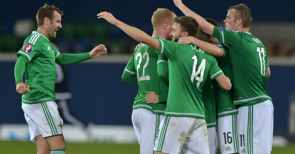 Northern Ireland: Players celebrate their progress to Euro 2016