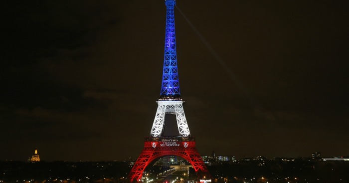 The Eiffel Tower is illuminated in Red, White and Blue in honour of the victims of Friday's terrorist attacks on November 16, 2015 in Paris, France. Countries across Europe joined France today to observe a one minute-silence in an expression of solidarity