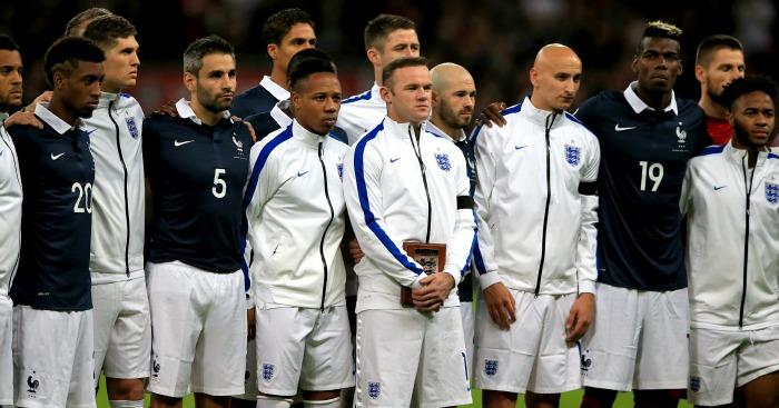 Wayne Rooney: Stands alongside England and France players to remember Paris victims