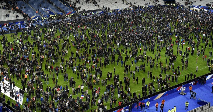 Stade de France: Fans on pitch following terror attacks