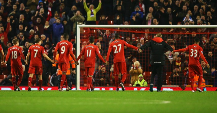 Liverpool's players salute the Kop