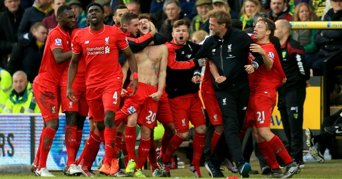 Adam Lallana: Mobbed after Liverpool's winner at Norwich
