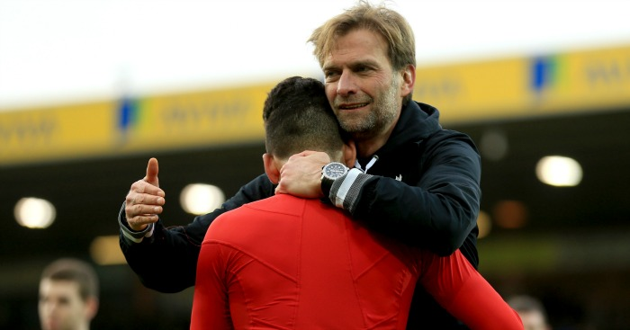 Jurgen Klopp: Celebrates Liverpool's win with Roberto Firmino