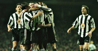 Newcastle: Celebrate a goal at Anfield in January 1996