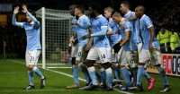 Sergio Aguero: Mobbed after City's late winner at Watford