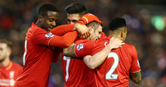 James Milner: Celebrates Liverpool's second with team-mates