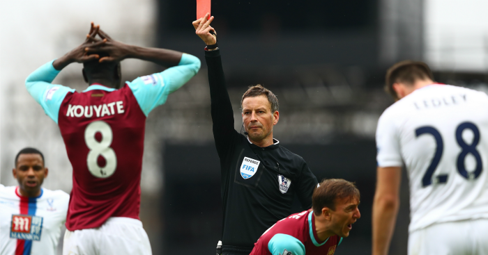 Mark Noble can't believe it as Mark Clattenburg dismisses Kouyate