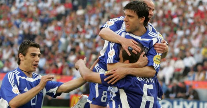 Angelos Basinas: Mobbed by teammates in 2004.
