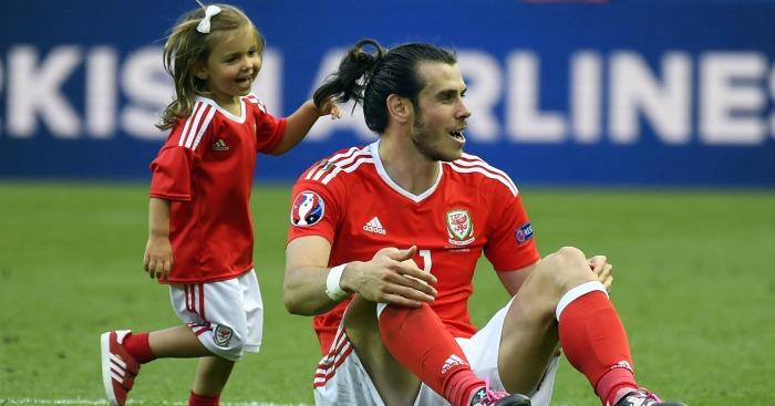 Gareth Bale: Celebrates with his daughter at full-time