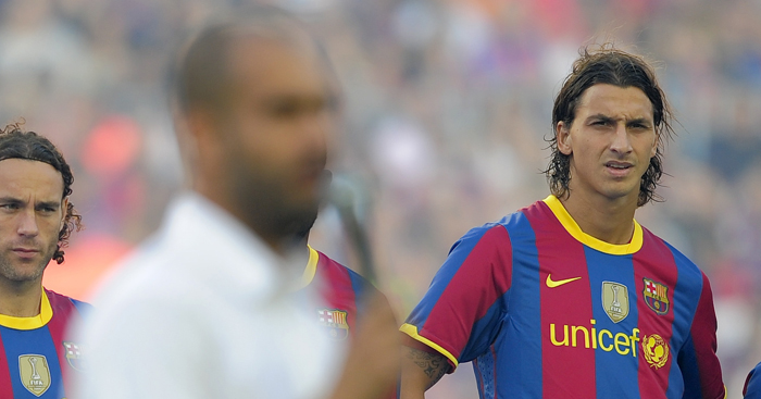 Barcelona's Swedish forward Zlatan Ibrahimovic (R) listens to his coach Josep Guardiola (Front) prior to their 45th Trophy Joan Gamper friendly football match against AC Milan at Camp Nou stadium in Barcelona on August 25, 2010. AFP PHOTO/ JOSEP LAGO (Photo credit should read JOSEP LAGO/AFP/Getty Images)