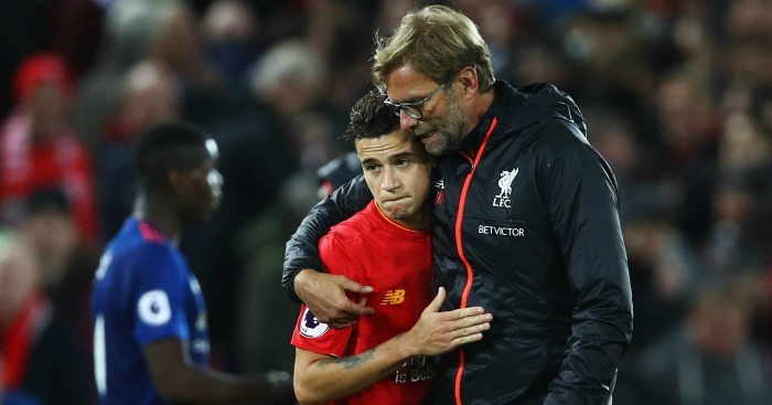 Jurgen Klopp: Shares a hug with Philippe Coutinho