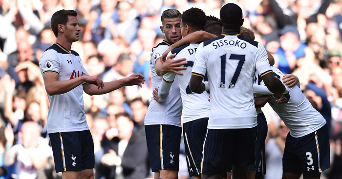 Tottenham's players celebrate taking the lead after Manchester City's Serbian defender Aleksandar Kolarov's own goal during the English Premier League football match between Tottenham Hotspur and Manchester City at White Hart Lane in London, on October 2, 2016. / AFP / Glyn KIRK / RESTRICTED TO EDITORIAL USE. No use with unauthorized audio, video, data, fixture lists, club/league logos or 'live' services. Online in-match use limited to 75 images, no video emulation. No use in betting, games or single club/league/player publications.  /         (Photo credit should read GLYN KIRK/AFP/Getty Images)