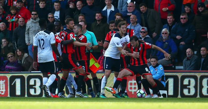 Scuffle: Harry Arter reacts angrily to apparent elbow
