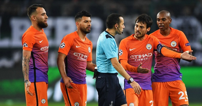 Unhappy: Man City players contest red card