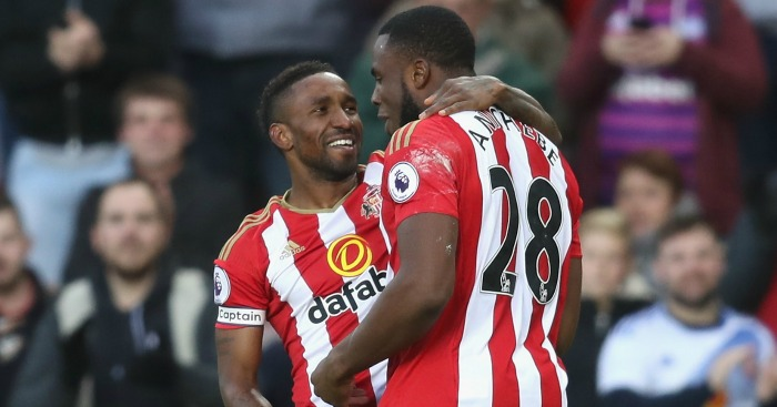 Jermain Defoe: Celebrates with fellow scorer Victor Anichebe