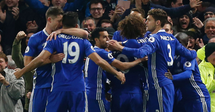 Celebrations: Chelsea congratulate matchwinner Moses