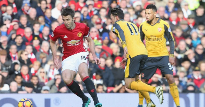 Michael Carrick: Midfielder in action against Arsenal
