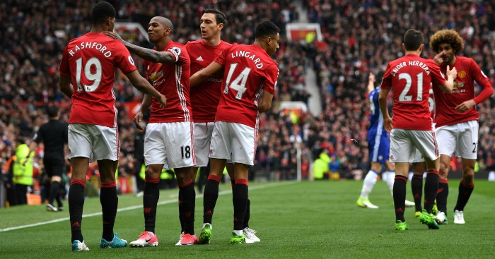 manchester united thrust the title race open as the ran out comfortable 2 0 winners against table toppers chelsea at old trafford