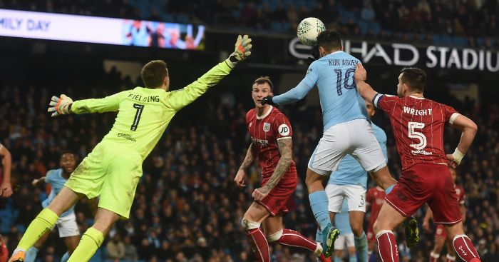 Aguero at the double as Man City keep quadruple bid alive