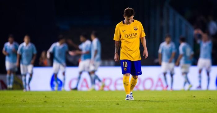 Lionel Messi: Looks dejected as Celta Vigo celebrate scoring against Barcelona