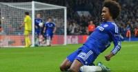 Willian: Celebrates scoring Chelsea's winner against Dynamo Kiev