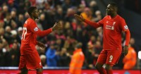 Divock Origi: Celebrates a Liverpool goal with Christian Benteke