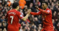 Luis Suarez: Hopes to see Liverpool back among the elite soon