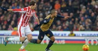 Philipp Wollscheid: Could have been penalised for tripping Theo Walcott