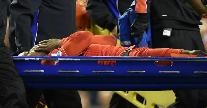 Divock Origi: Stretchered off at Anfield