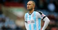 Joel Lynch: QPR keen on Huddersfield defender