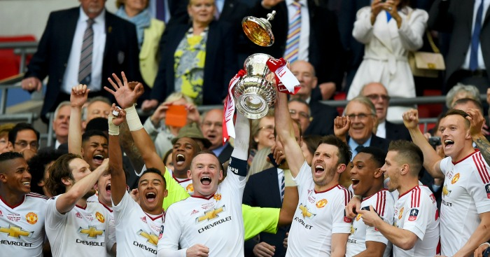 Wayne Rooney: Captain lifts trophy with Michael Carrick