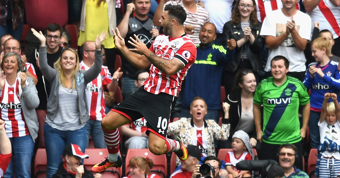 Charlie Austin: Celebrates winner in front of Saints fans