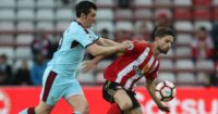 Joey Barton: In action again for Burnley
