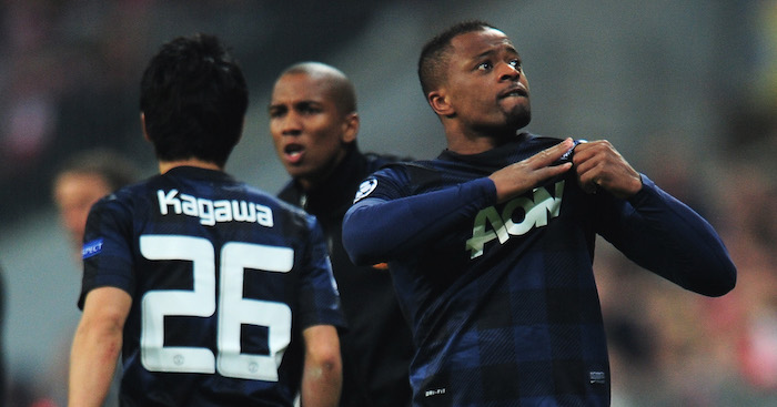 MUNICH, GERMANY - APRIL 09: Patrice Evra of Manchester United celebrates his goal during the UEFA Champions League Quarter Final second leg match between FC Bayern Muenchen and Manchester United at Allianz Arena on April 9, 2014 in Munich, Germany. (Photo by Shaun Botterill/Getty Images)